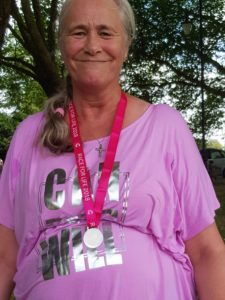 Elizabeth standing proudly with her finishers medal