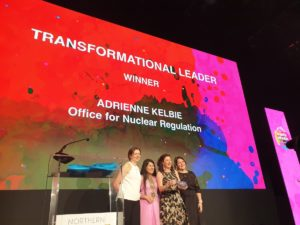 Adrienne pictured receiving her award for Transformational Leader.