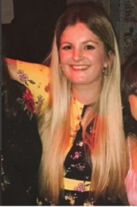 Jennifer with long blonde hair before having it cut off