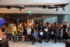 Staff, volunteers and Our Future graduates together at the Graduation Event at EY Foundation's offices.
