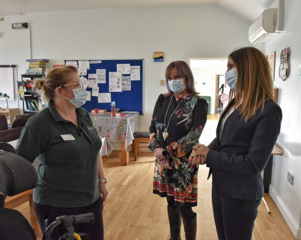 Dr Rosena Allin-Khan speaking to a staff member during her visit with the Oakleaf Group.